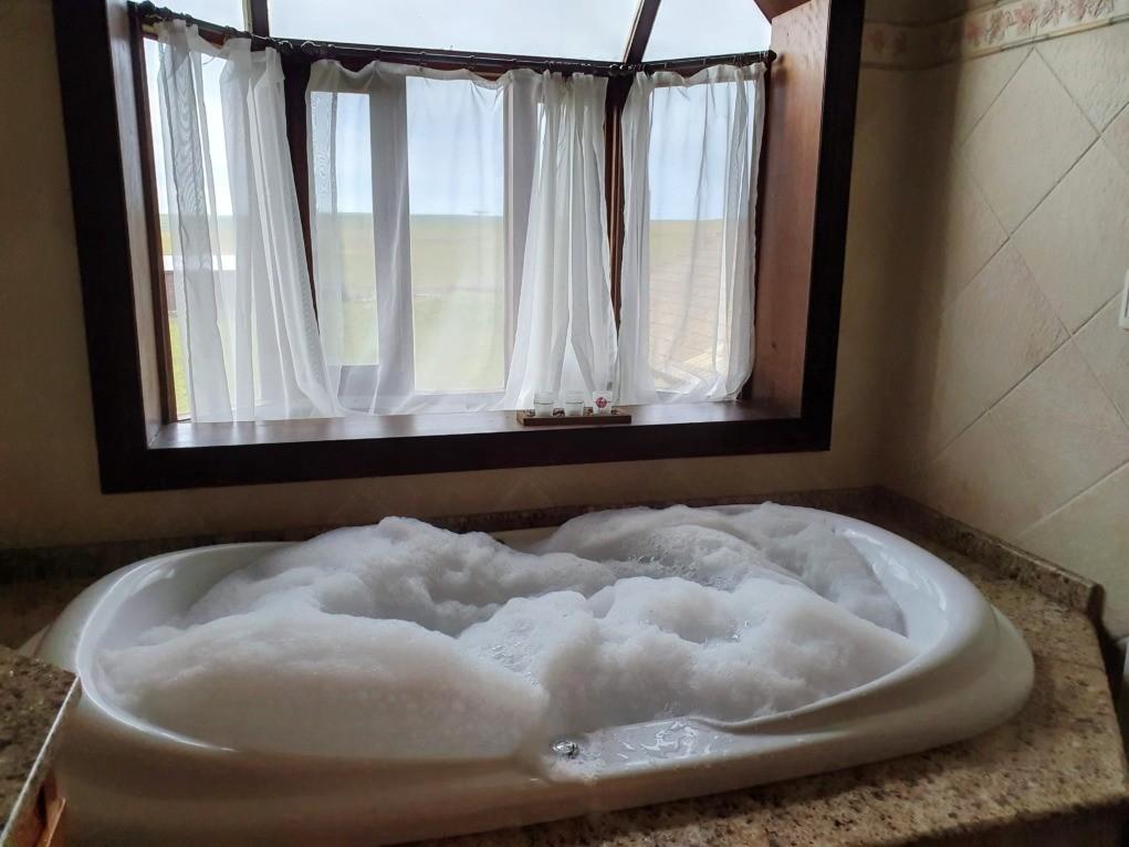 banheira de espuma pousada estancia das flofres